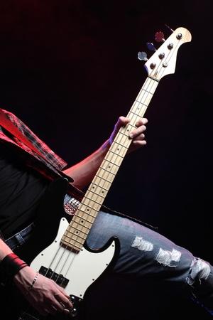 bass player: a bassist plays at rock concert