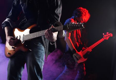 music band: rock musicians playing at a live concert