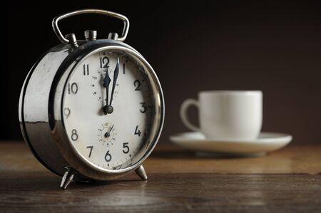 coffee hour: Alarm clock and coffee cup