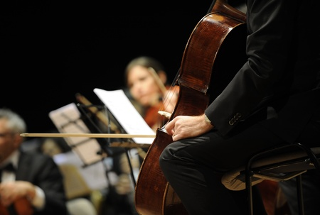 classical music: playing  chello during a classical concert music