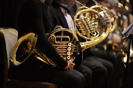 played: french horn during a classical concert music Stock Photo