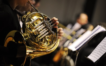 orchestra: french horn during a classical concert music Stock Photo