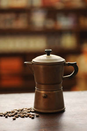 with coffee maker: old coffee maker on wooden table