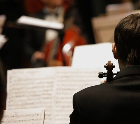 symphony orchestra: violinists during a classical concert music Stock Photo