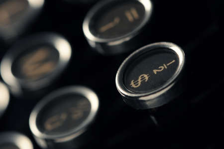 Close up photo of antique typewriter keys, shallow focus on dollar symbol photo