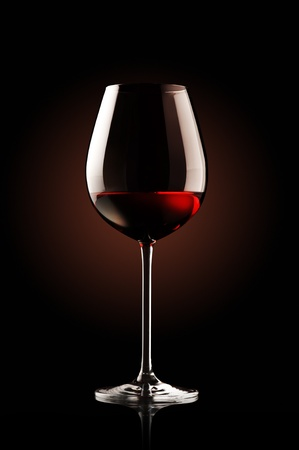 glass of red wine: re wine glass on black background