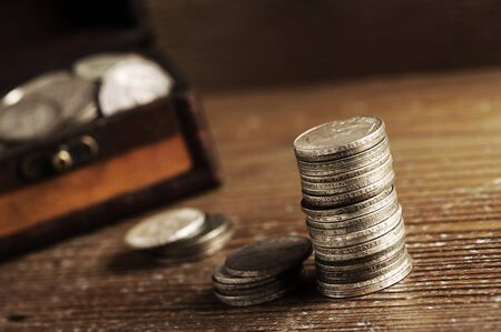 old coins: piles of old coins on wooden table