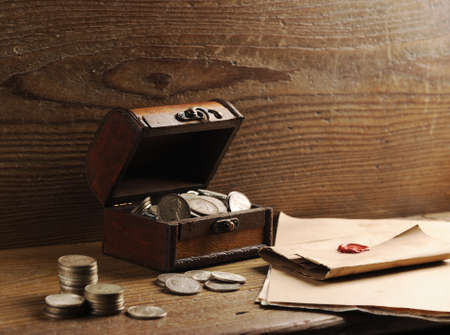 Treasure chest, old coins and mail paper photo