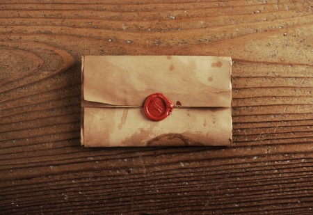 wax seal on a letter paper , background is wooden table photo