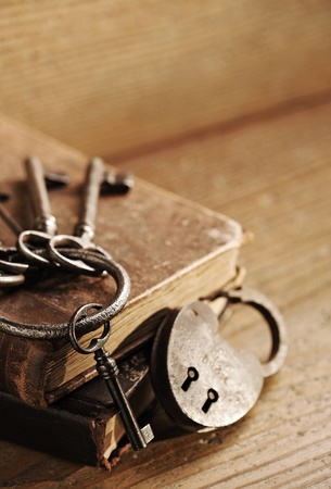 antique key: old keys on a old book, antique wood background Stock Photo