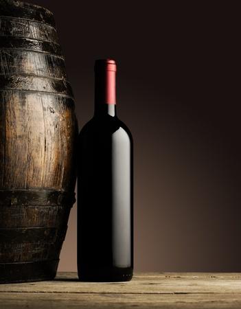 wine cellar: red wine bottle and wodden barrel