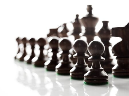 battling: Chess pieces ready to do battle. Stock Photo