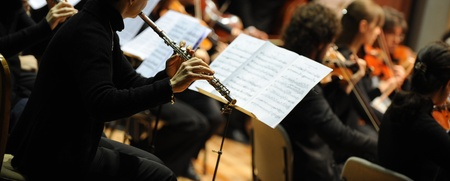 Woman playing flute during a classical concert music