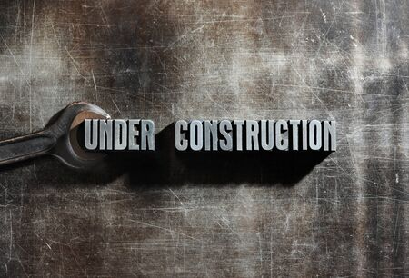 web page under construction: Image of a Under Construction sign with a metallic background texture
