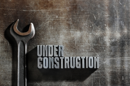 under construction: Image of a Under Construction sign with a metallic background texture