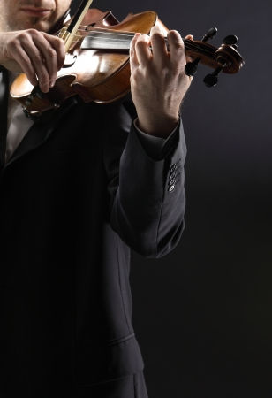 the violinist: Musician playing violin on dark background Stock Photo - 12274029
