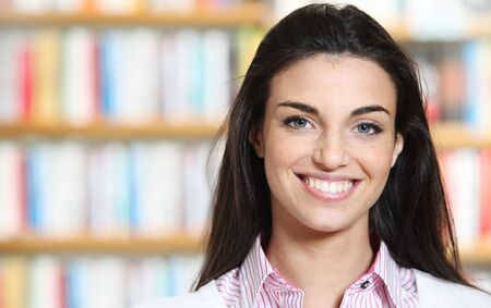 smiling young female showing a business card  -  copy space. Stock Photo - 12274041