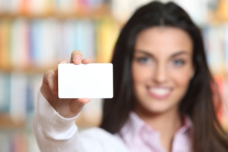 notecard: smiling young female showing a business card  -  copy space. Stock Photo