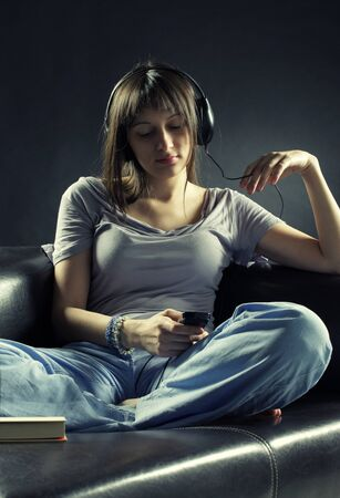 Relaxed young woman listening music photo