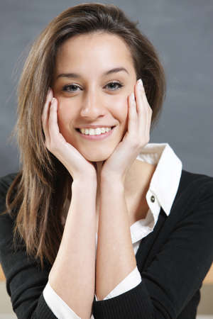 Close-up of a young woman smiling  Stock Photo - 12577747