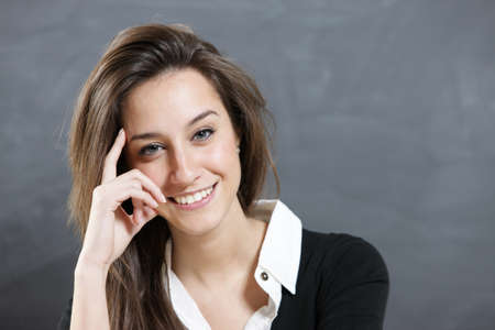 Close-up of a young woman smiling  Stock Photo - 12577580