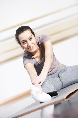 portrait of cute young woman exercising  Stock Photo - 12577367