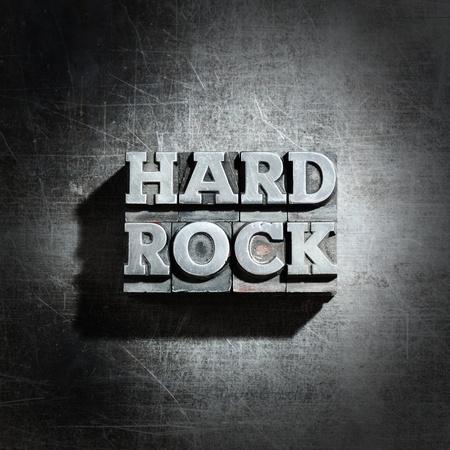 rock music: metal HARD ROCK background :  antique metal letter-press type.