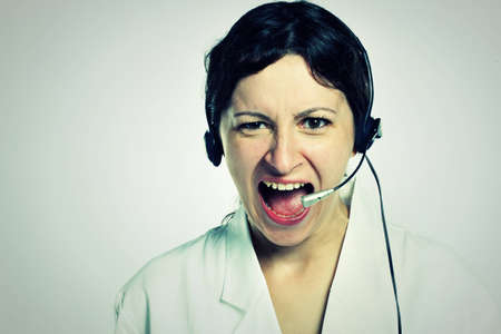 portrait of angry girl with headset photo