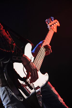bassist: close up of hands playing an bass