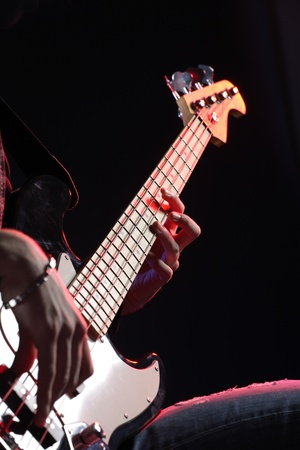 fidelity: a bassist plays at a live concert Stock Photo