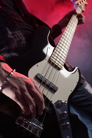 bass player: a bassist plays at a live concert Stock Photo