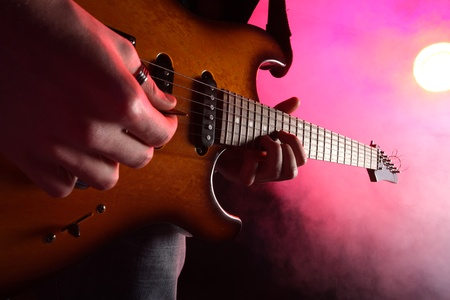 guitar player in action on stage Stock Photo - 12625356