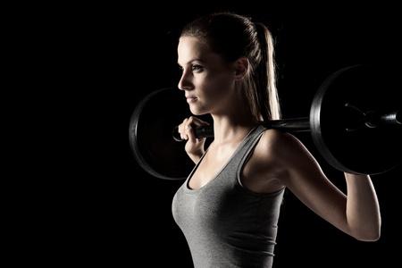 training: jonge vrouw gewicht opleiding