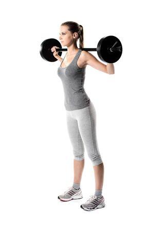 levantar peso: mujer joven de entrenamiento con pesas
