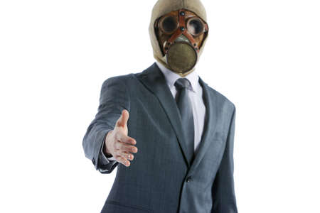 portrait of businessman in a gas mask offering for handshake photo