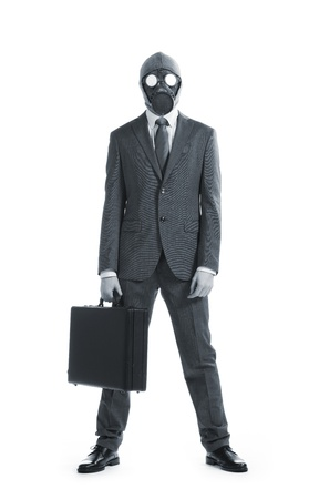 gas mask: portrait of businessman in a gas mask  with suitcase Stock Photo