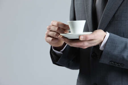 close up business man with coffee cup photo