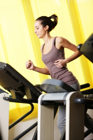 gym: young woman Running on treadmill  photo