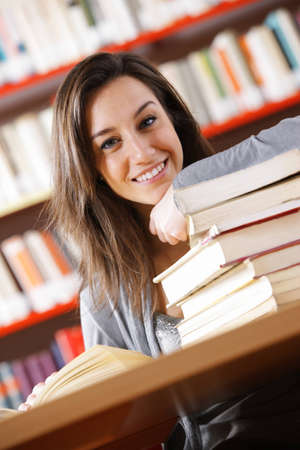 smiling college student with a stack of books Stock Photo - 12844389