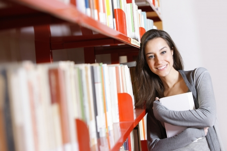 Female Student: Happy in the Library Stock Photo - 12844422