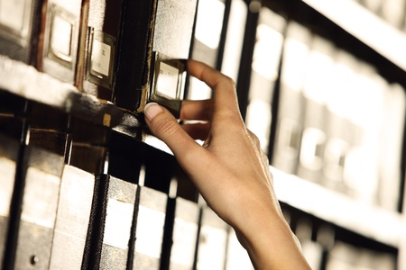 archives: Searching in archives. Student hands searching from a filling cabinet.