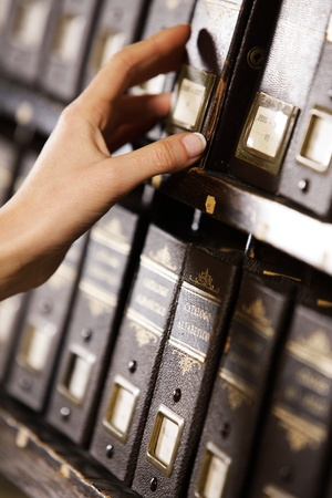 Searching in archives. Student hands searching from a filling cabinet.  photo