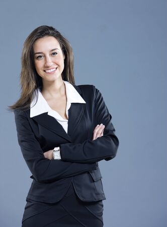 Attractive businesswoman with her arms crossed. Stock Photo - 12844360