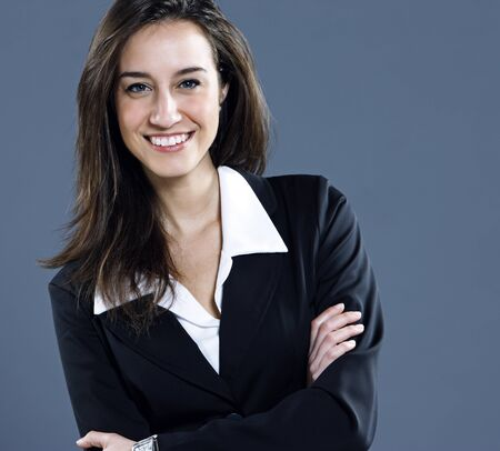 Attractive businesswoman with her arms crossed. Stock Photo - 12844424