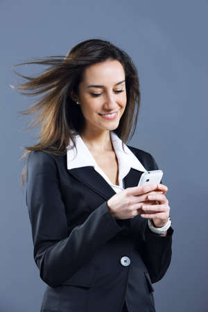 woman business,  text messaging on cell phone Stock Photo - 12844415