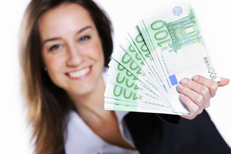 Excited young woman holding cash photo