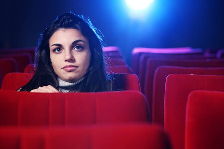 portrait of a pretty young woman at cinema photo