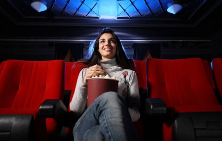 watching a movie at the cinema: portrait of a pretty girl in a movie theater photo