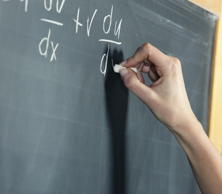 mathematical proof: Close-up of a stundens hand solving maths problem Stock Photo