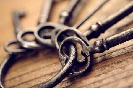 skeleton key: old keys on a wooden table, close-up